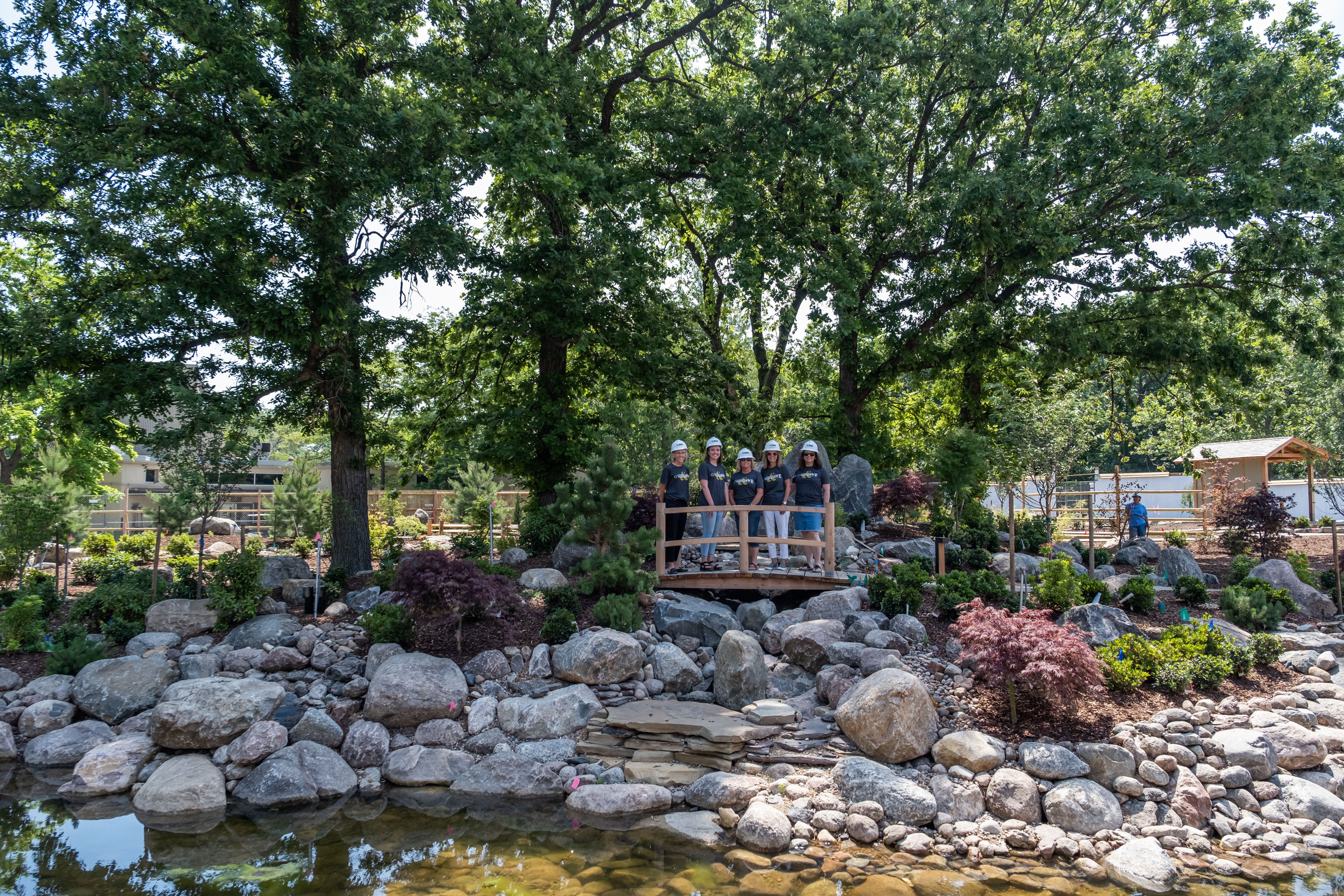 five people standing on small bridge in Japanese Garden at Topeka Zoo